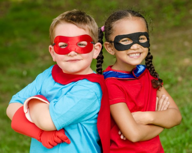 two kids dressed like super heroes(shutterstock)