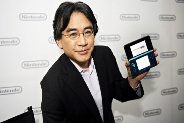 Nintendo chief executive Satoru Iwata and the 3DS handheld device, which has sold poorly.