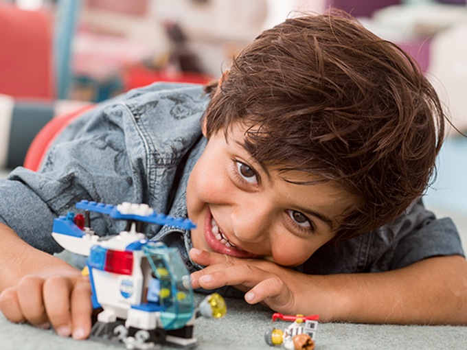 Boy-playing-with-LEGO-Junior