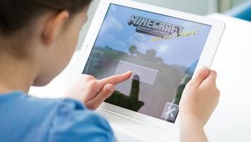 Little girl playing Minecraft on Apple iPad Air