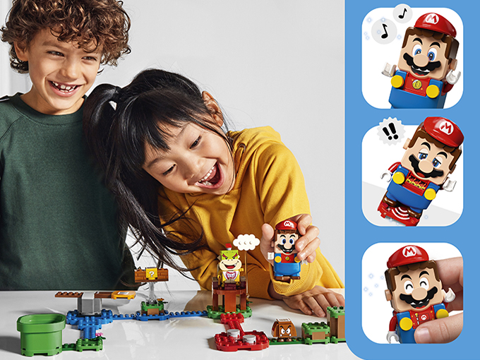 Kids playing with LEGO Super Mario