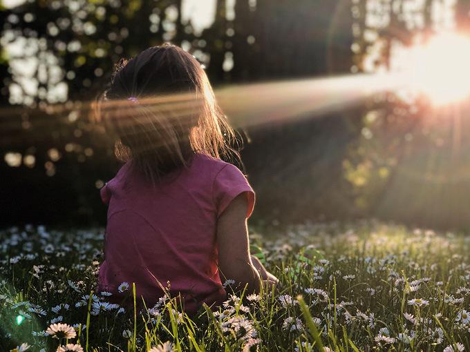 Kid looking to sun