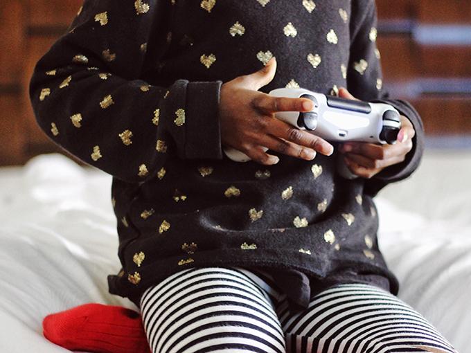 kid playing video games