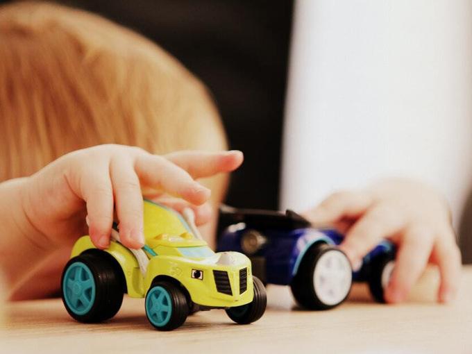 kid playing with toys unsplash sandy millar