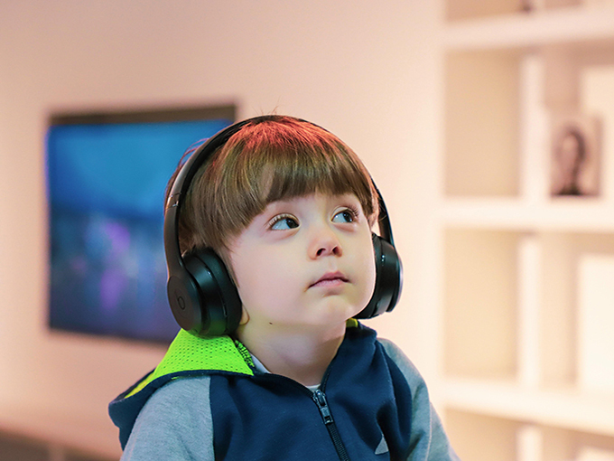 kid with headphones unsplash