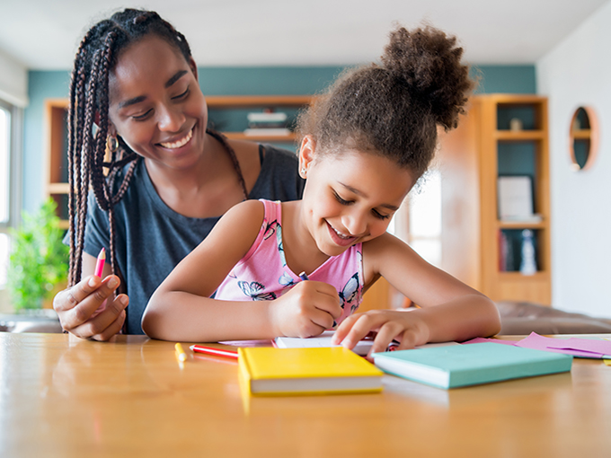 A father helping her daughter with homeschool.